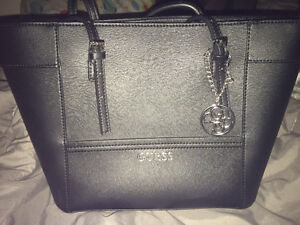 Many name brand purses in mint or brand new condition