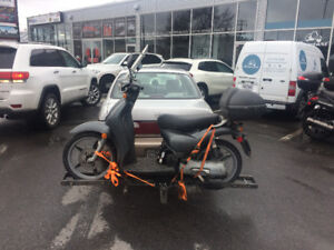 Scooter/Moped transport, 40 cents per kilometer + $20 per hour