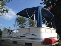 WOW A 2006 PONTOON WITH FOUR STROKE FOR 10,700.00