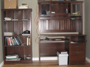 computer desktop and bookcase