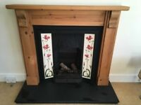 Solid pine surround with cast iron fireplace