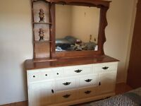Dresser with integrated mirror