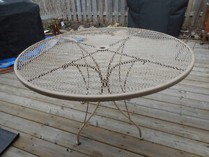 Wrought iron patio set - table and 4 chairs in good condition