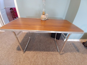 Folding table, light weight, stores in small space, Orangeville.