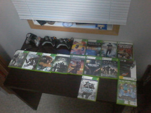 14 Xbox 360 games, xbox 360 (red ring), and 3 controllers.