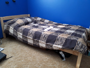 Twin bed frame with foam mattress