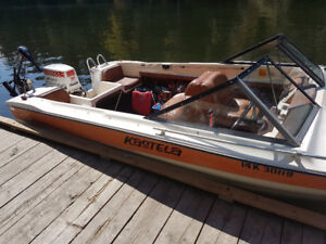 Boat c/w skis, anchor, tow rope, spare fuel tanks