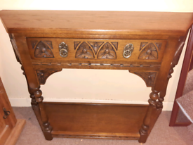 Carved wooden hall table