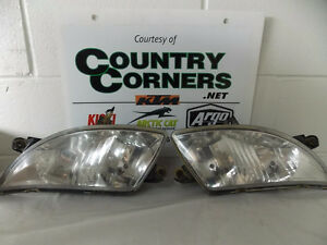 USED 2006 TRV 400 FRONT HEADLIGHTS