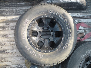 8 BOLT GMC RIMS AND TIRES...RIMS ONLY ON TRUCK ONCE