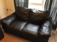 DFS black leather sofa 2-3 seater - 2 years old
