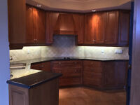 Maple kitchen cabinets with appliances and granite counter