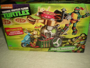 Teenage Mutant Ninja Turtles Motorized Pizza Thrower Vehicle NIB