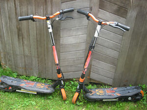 two pulse motorized scooters