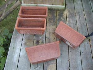 4 matching heavy clay planters