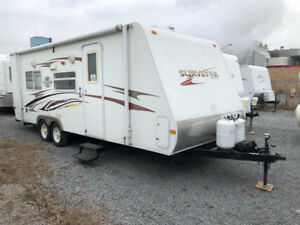 2009  Survey rear hard slide out with bunks $8,900