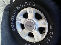 KEEP THE WINTER ON **** LIGHTLY USED TIRES & FORD ALLOY WHEELS !