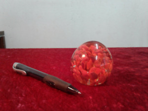 Vintage small glass paperweight .