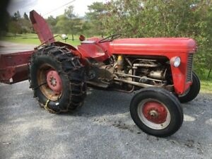 MF 35 tractor with chains and snowblower. Starts  in any temp. c