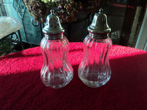 Two Glass Shakers