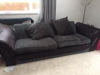 Three seater grey and black sofa