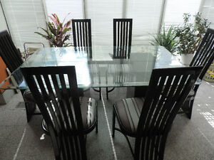 Glass top dining Table with 6 metal dining chairs