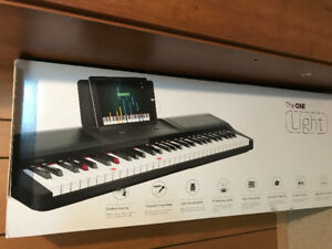 The ONE Piano Keyboard with stand