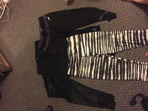 Four pairs of Nike, adidas and avia gym pants size small