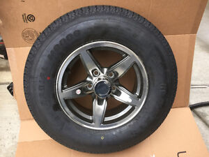 "Brand new 14 "" aluminum wheel and tire"