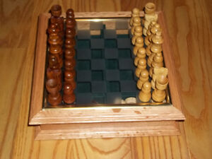 very nice hardwood chess and checkers set with glass board.