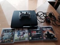 PlayStation 3 in excellent condition with 4 games and a controller