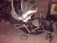 black and brown duo glider double stroller & car seat
