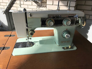 Vintage Kenmore Sewing Machine with cabinet