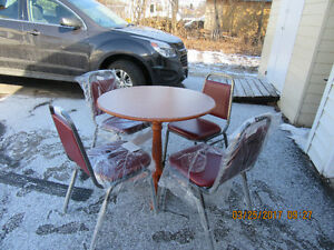 Table with 4 New chair's  ******** More hotel furniture for sale