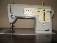 Singer sewing machine, cabinet and chair.