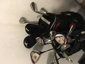 Golf clubs, bags, and pair of shoes