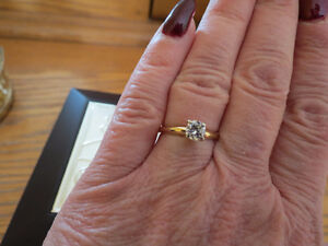 SOLITAIRE, 0.60 CT. VALUED AT $3000 (appraisal included)