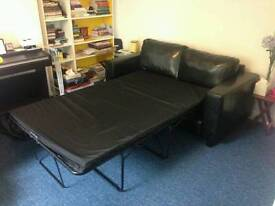 Black Sofa Bed. Like New Condition. Was £650 now only £200. *Delivery available*