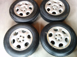 4 Lightly used 205/70R15 tires on 15in Subaru Factory rims
