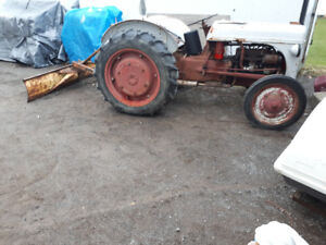 tractor with blade & 2  snow plows, etc