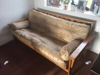 Confortable solid wood sofa bed.