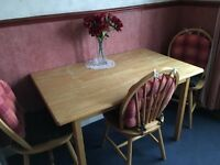 Pine table and four chairs for sale.