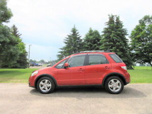 2010 Suzuki SX4 AWD- Hatchback.  ONE OWNER & 4 NEW TIRES!!