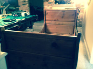 Solid single wood sleigh bed . Paid $800 new