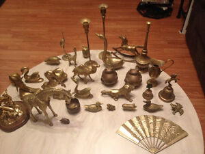 Selling a large assortment of brass ornaments. Candle holders,