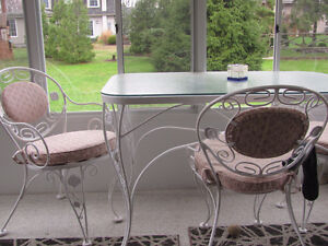 wrought iron table , 4 chairs