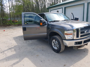 2010 f-250 xlt  extended cab 8ft box with 8.5ft artic plow
