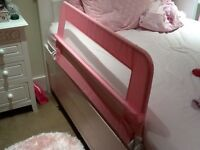 Girls pink 2 foldable bed guards from Safetots