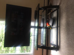 LG smart tv with glass stand.