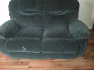 Dark green love seat with 2 recliners